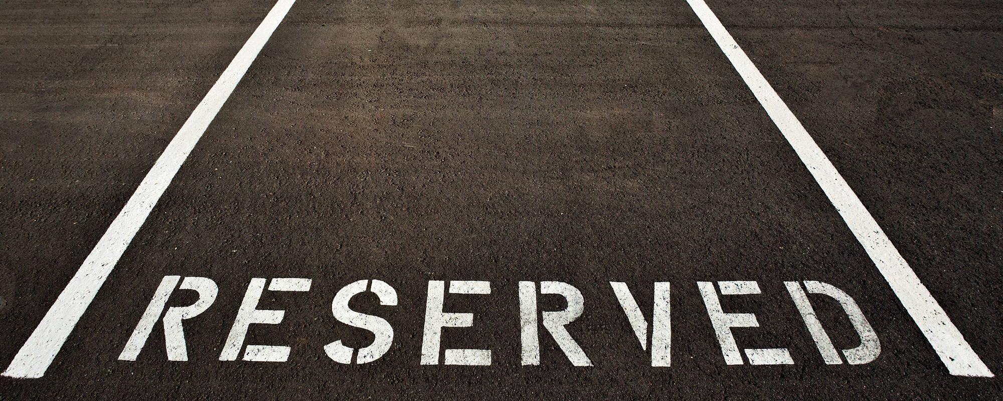 A reserved parking painted in white